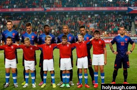 Footballer refuses to stand behind tall ball boy